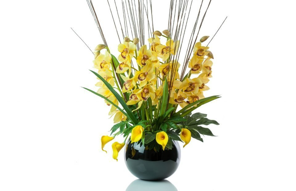 Faux Yellow cymbidium orchid display in black fishbowl